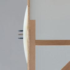 View of cross section of GeeFix with shelf bracket fixed onto hardboard