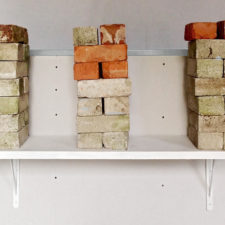 Shelf brackets each fixed with just one GeeFix into single thickness 12.5 mm plasterboard (NOT the timber stud!) Total weight of bricks 294 lbs/134 kg